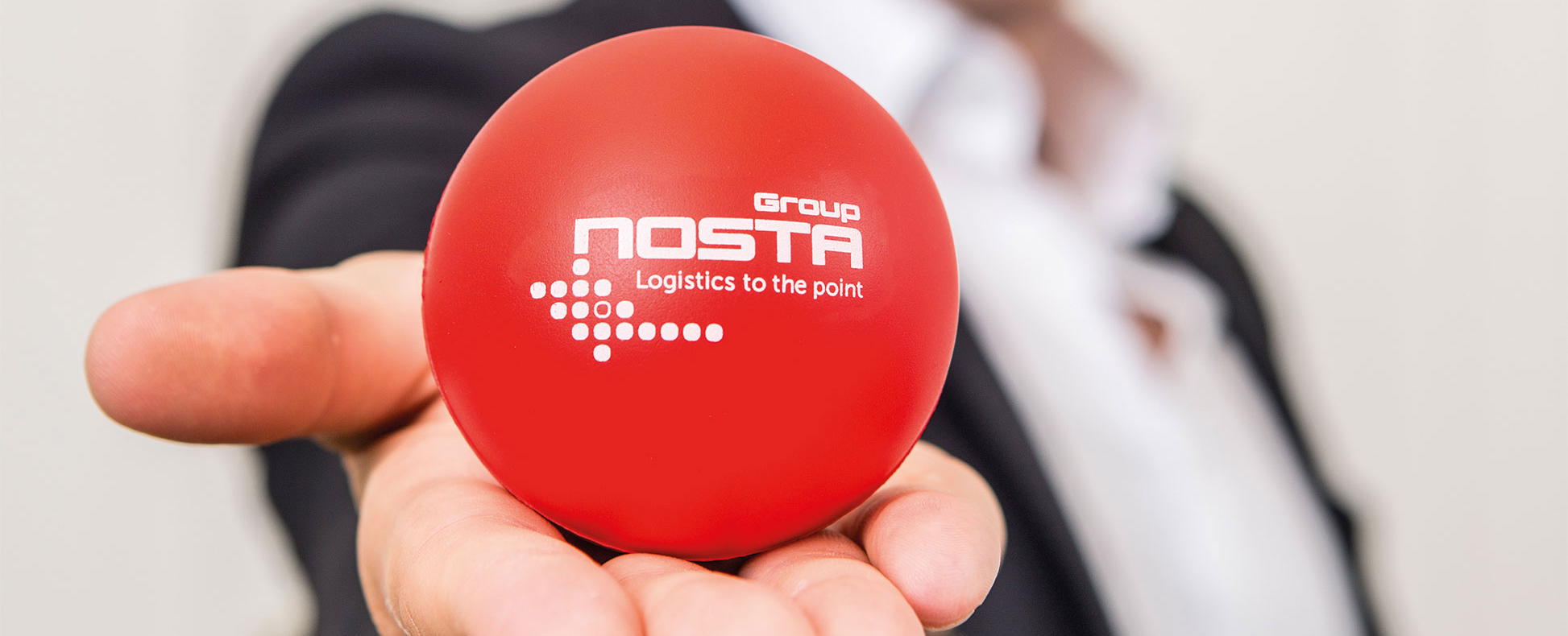NOSTA Group mission statement with red NOSTA ball