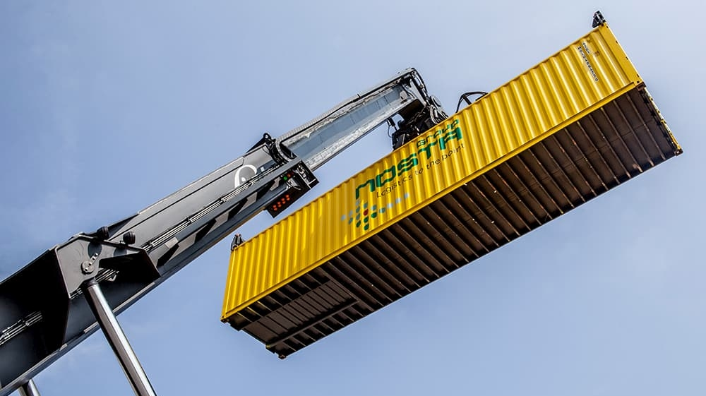 Reachstacker lifts containers into the air